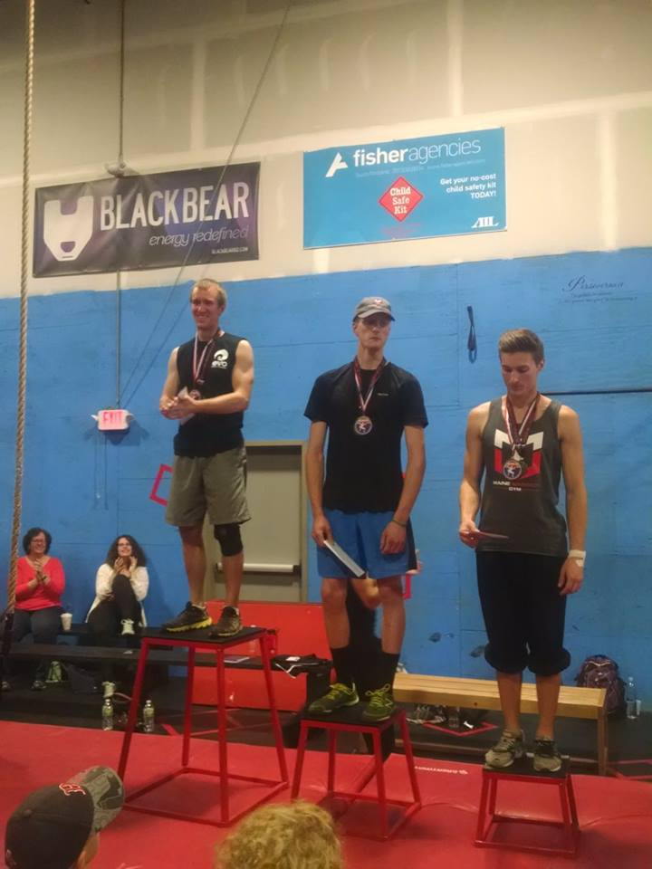 Sean stands on podium for first place at Maine Warrior Gym in Westbrook, ME
