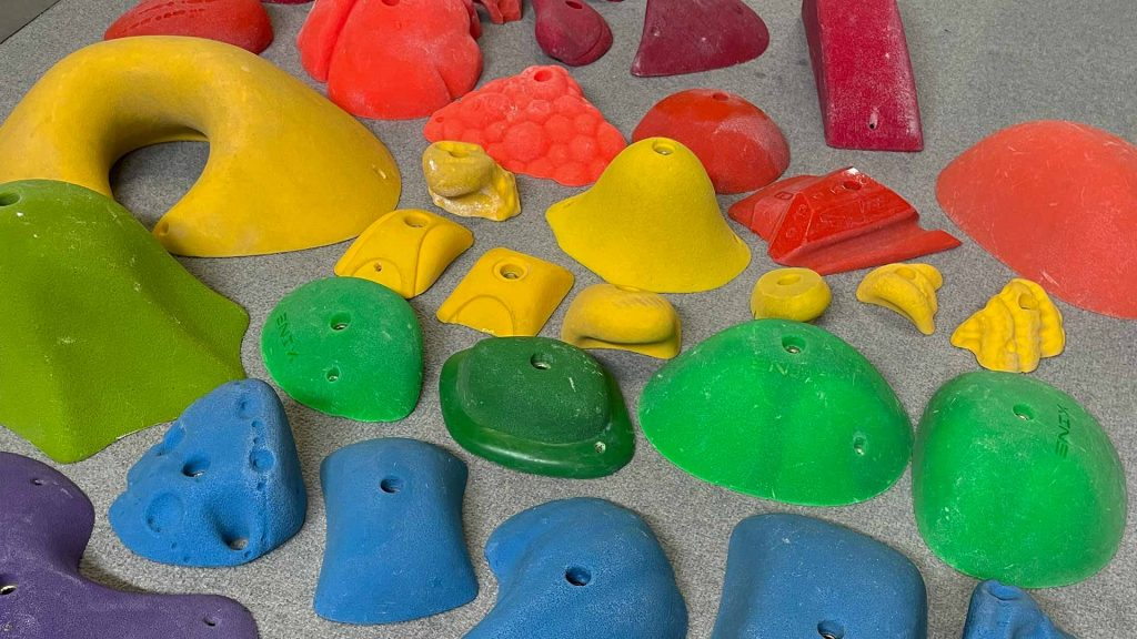 Climbing holds arranged to form a rainbow